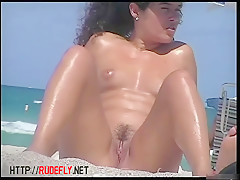 Shaved and hairy amateur pussies on hidden cam beach
