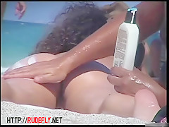 Sexy naked people in a beach spy voyeur video