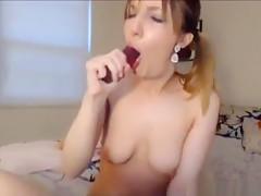 Hot brunette shows deepthroat skills with dildo