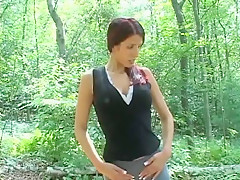 Desperate woman pissing in small cup 05 outside