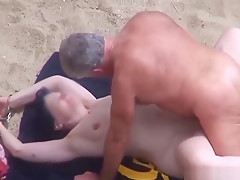 Old couple doesn't care and fucks on the beach