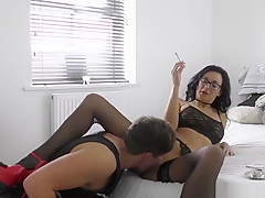 Licking the classy girl's pussy while she is smoking
