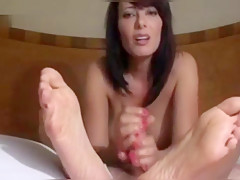 Sexy mature woman does a handjob showing these soles