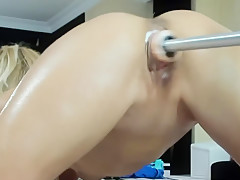 Skinny girl getting her pussy fucked my a machine