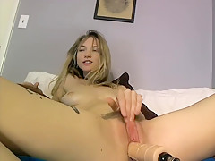 Sexy girl rubs her pussy with dildo inside