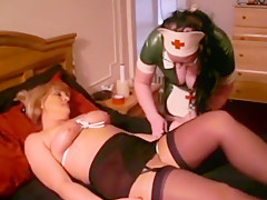 Jane wrapped, tied and gagged by latex nurse
