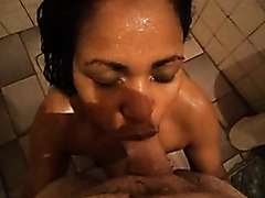 Hot slut giving blowjob under shower