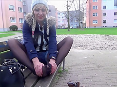 Amusing Footjob in the park seems