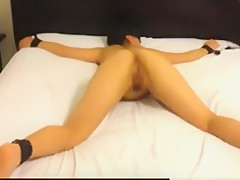 Tied up asian girl sucks her white bf's cock