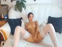 Beautiful brunette on a white sofa