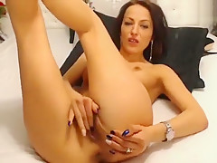 Lorrette fingering her pussy