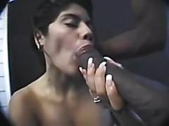 Latina sucks a big black pecker