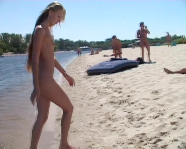 Quality voyeur video of a nudist girl spreading her thighs 2