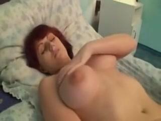 Busty overweight babe masturbates on ottoman
