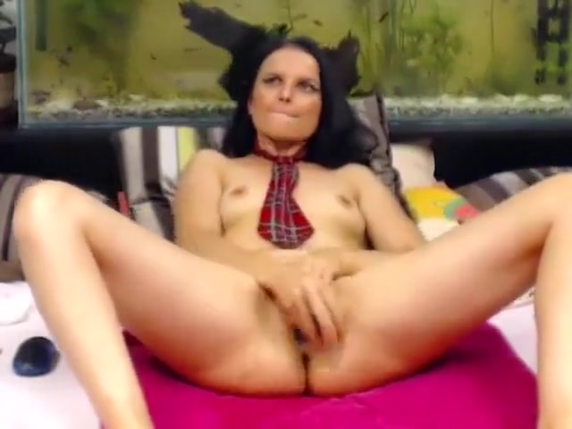 Chick in a tie phantasmagorically inspects her cunt with