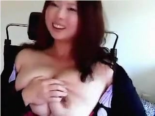 30 years old Korean lady showing off her breasts
