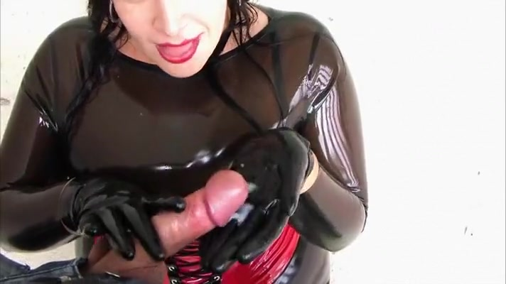 Latex bitch uses his big cock for a handjob